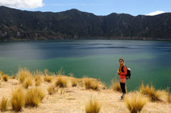 Tourist in Ecuador. Tourist on the edge of the volcano crater lake, Quilotoa, Ecuador Stock Photography