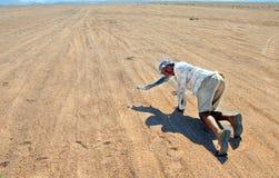 Tourist in Egyptian desert Royalty Free Stock Photos