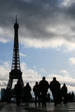 Tourist and the eiffel tower. Silhouetted tourists looking at the eiffel tower in trocadero, paris, france royalty free stock photo