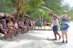 Tourist enjoing cultural show on Koromiri Island in Rarotonga Co. Tourists enjoying cultural show on Koromiri Island in Rarotonga Cook Islands. About 100,000 Royalty Free Stock Image