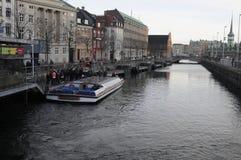 TOURIST ENJOY CANAL TOUR IN COPENHAGEN Stock Photography