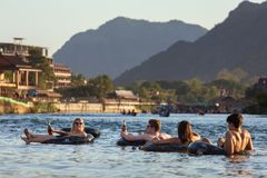 Tourist enjoy tubing in Song River at Vang Viang, Laos. Vang Vieng, Laos - January 21, 2017: Tourist enjoy tubing in Song River at Vang Viang, Laos Royalty Free Stock Image