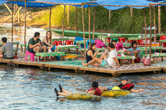 Tourist enjoy tubing in Song River at Vang Viang, Laos. Vang Vieng, Laos - January 19, 2017: Tourist enjoy tubing in Song River at Vang Viang, Laos Royalty Free Stock Image