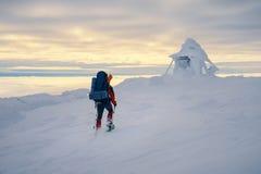 Feel freedom and enjoy beautiful winter mountains. Tourist enjoying beautiful landscape and feel freedom in winter mountain at sunset. Winter sport activity Stock Photography