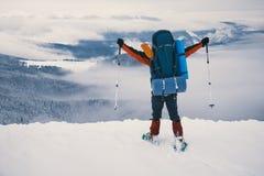 Feel freedom and enjoy beautiful winter mountains. Tourist enjoying beautiful landscape and feel freedom in winter mountain at sunset. Winter sport activity Royalty Free Stock Photography