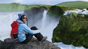 Tourist enjoying the beautiful view of Godafoss waterfall stock footage