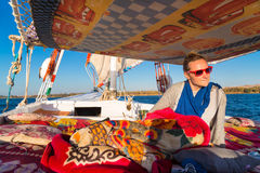 Tourist enjoying felucca trip on the Nile Royalty Free Stock Images