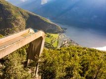 Tourist enjoying fjord view on Stegastein viewpoint Norway royalty free stock photos