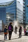 Tourist enjoying fountains. LONDON, UK - MARCH 25, 2016: Tourist enjoying fountains on a sunny Spring day royalty free stock image