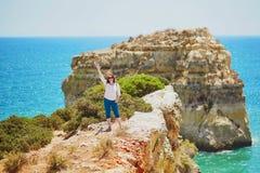 Tourist enjoying scenic landscape in Algarve, Portugal Royalty Free Stock Images