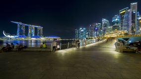 Tourist enjoying Singapore cityscape view. Singapore - November 27, 2017: Tourist enjoying beautiful cityscape of Marina Bay Sands Singapore from Esplanade Stock Image
