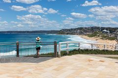 Tourist enjoying the view - Bar Beach NEwcastle Australia. A woman enjoys the view of Bar beach - Merewether in Newcastle Australia. Bather`s way is a newly royalty free stock photo