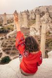 Tourist enjoying view of love valley canyon in Cappadocia, Turkey royalty free stock photo