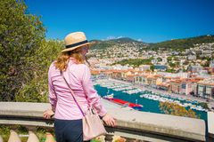 Tourist enjoying view over city of Nice in France. Tourist woman enjoying view over city of Nice in France Stock Photos