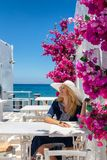 Tourist enjoys her summer vacation on a typical Greek island in the Cyclades stock image