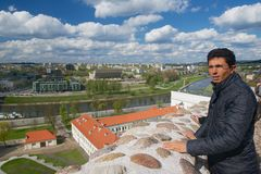 Tourist enjoys the view to the city from Gediminas hill in Vilnius, Lithuania. stock photos