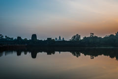 Tourist entering Angkor Wat panorama across the moat Cambodia Royalty Free Stock Images