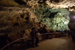 Tourist entering Borra Caves Stock Photos