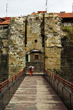 Tourist entering a medieval town Royalty Free Stock Photography