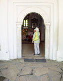 A tourist entering the temple of the monastery of Dryanovo, Bulgaria Stock Image