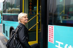 Tourist enters to the bus in China Royalty Free Stock Images