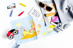 Tourist equipment with map and toys for traveling with kids on white background top view Stock Photos