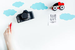 Tourist equipment with toys and camera for traveling with kids on white background top view mock up Stock Photo