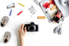 Tourist equipment with toys and camera for traveling with kids on white background top view Stock Photos