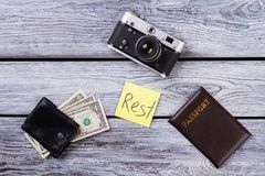 Tourist essentials for vacation. Travel and rest concept, flat lay. Wooden desk background Stock Photography