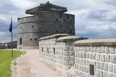 Tourist explores Hwaseong fortress (Brilliant Fortress) and tower in Suwon, South Korea. Royalty Free Stock Photos