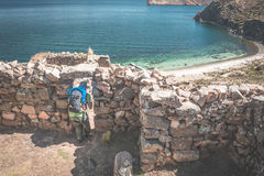 Tourist exploring the ancient mysterious Inca labyrinth-like settlement, called Chinkana, on the Island of the Sun, Titicaca Lake,. Bolivia. Travel adventures Royalty Free Stock Image