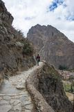 Tourist exploring the Inca Trails and the archaeological site at Ollantaytambo, Sacred Valley, travel destination in Cusco region, Royalty Free Stock Images