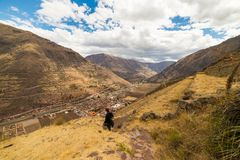 Tourist exploring the Inca Trails and the majestic terraces of Pisac, Sacred Valley, major travel destination in Cusco region, Per Stock Photos