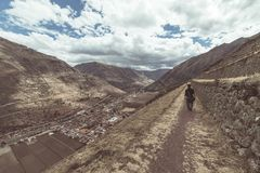 Tourist exploring the Inca Trails and the majestic terraces of Pisac, Sacred Valley, major travel destination in Cusco region, Per Royalty Free Stock Photos