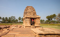 Tourist exploring Pattadakal temple, a Unesco heritage site Stock Photos