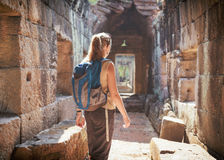 Tourist exploring the Preah Khan temple in Angkor, Cambodia Royalty Free Stock Images