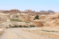 Tourist exploring the ruins of ancient Petra, Jordan Stock Images