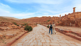 Tourist exploring the ruins of ancient Petra, Jordan Royalty Free Stock Images