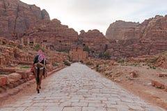 Tourist exploring the ruins of ancient Petra, Jordan Royalty Free Stock Photos