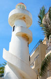 Tourist facilities and nature of Playa Del Carmen. Playa Del Carmen, Mexico, the lighthouse on  the beach Royalty Free Stock Photo