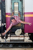 Tourist falls out of the train Royalty Free Stock Photo