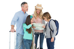 Tourist family consulting the map. On white background Royalty Free Stock Photo