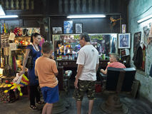Tourist family in Hoi An Barber shop. Hoi An, Vietnam - Dec 27, 2016: Tourist family in Hoi An Barber shop asking for the most popular vietnamese hair styles royalty free stock photos