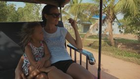 Tourist family mother and daughter riding on traditional tuk tuk transportation. Tourist family of mother and little daughter traveling in asia. They riding on stock video