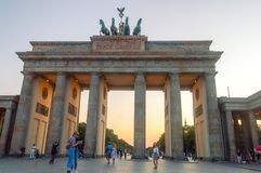 Tourist at famous Brandenburg Gate one of the most famous monuments in Berlin. royalty free stock photography