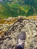 Tourist feet on mountain top Royalty Free Stock Photos