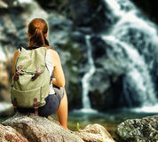 Female hiker looking at waterfall Stock Photography
