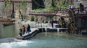 Tourist in Fenghuang,China. FENGHUANG - April 13: tourists are taking photo and admire the view at Fenghuang ancient town on April 13, 2015 in Fenghuang,China Stock Images