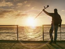 Tourist on ferry boat mole within sunrise or sunset. Warm colors royalty free stock photography