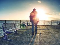 Tourist on ferry boat mole within sunrise or sunset. Warm colors stock photos